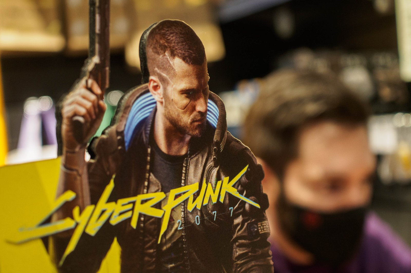 A promo of Cyberpunk 2077, the most anticipated game of 2020, is seen at the entrance to a video game store in Moscow, Russia, Dec. 10, 2020. (Photo by SOPA Images/Sipa USA via Reuters)