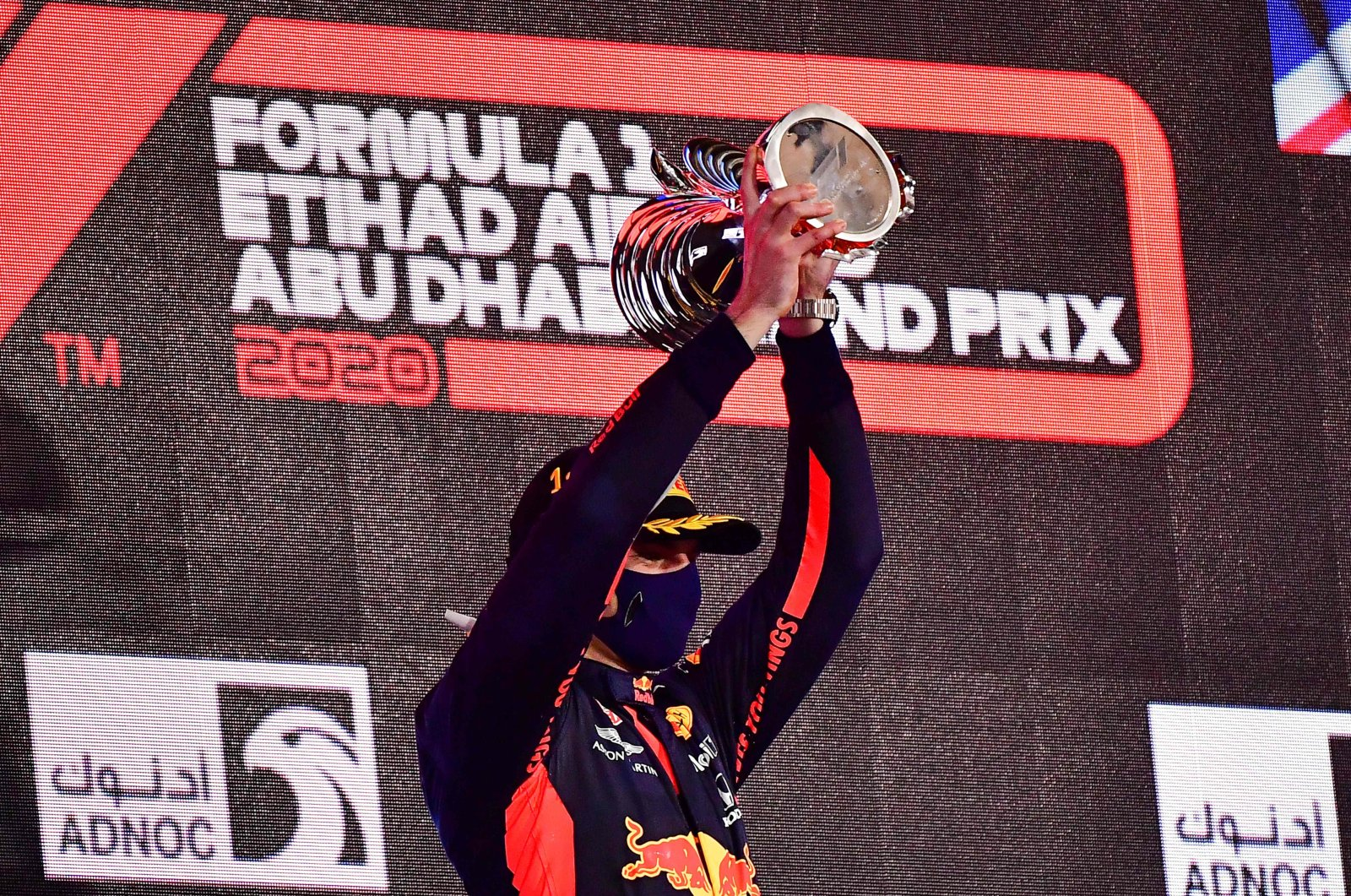 Red Bull driver Max Verstappen lifts his trophy on the podium after winning the F1 Abu Dhabi Grand Prix at the Yas Marina Circuit in Abu Dhabi, UAE, Dec. 13, 2020. (AFP Photo)