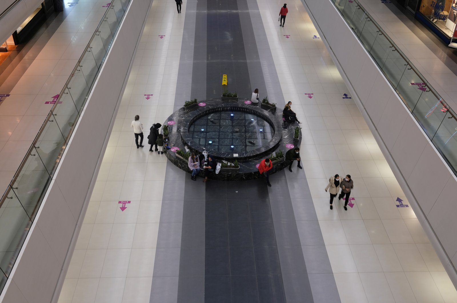 Direction and social distancing signs are seen on the floor at a shopping mall amid the coronavirus outbreak, in Istanbul, Turkey, Dec. 2, 2020. (Reuters Photo)