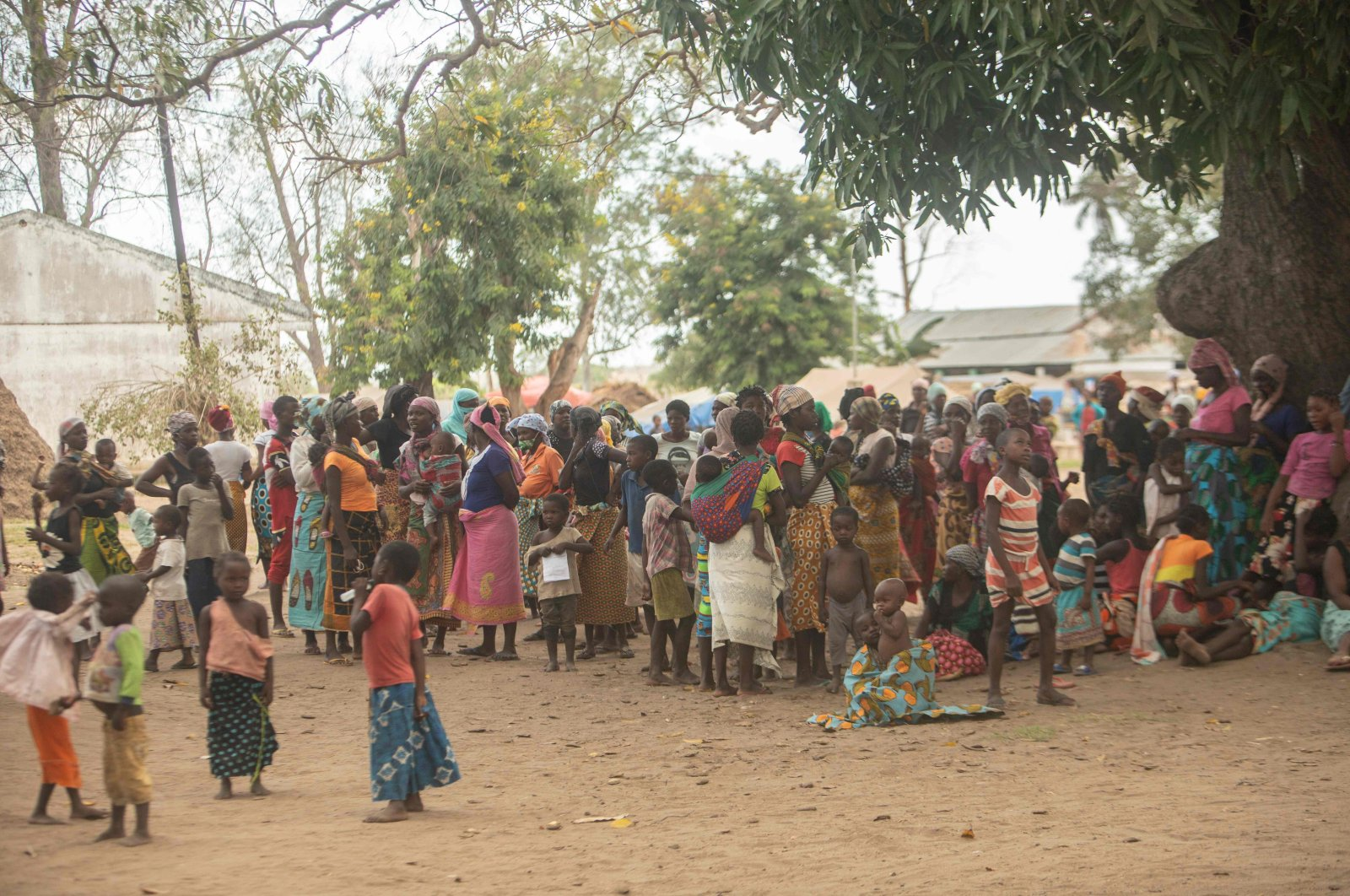 Displaced women meet at the Centro Agrrio de Napala where hundreds of displaced are sheltered after fleeing attacks by armed insurgents in different areas of the province of Cabo Delgado, in northern Mozambique, on Dec. 11, 2020. (AFP Photo)