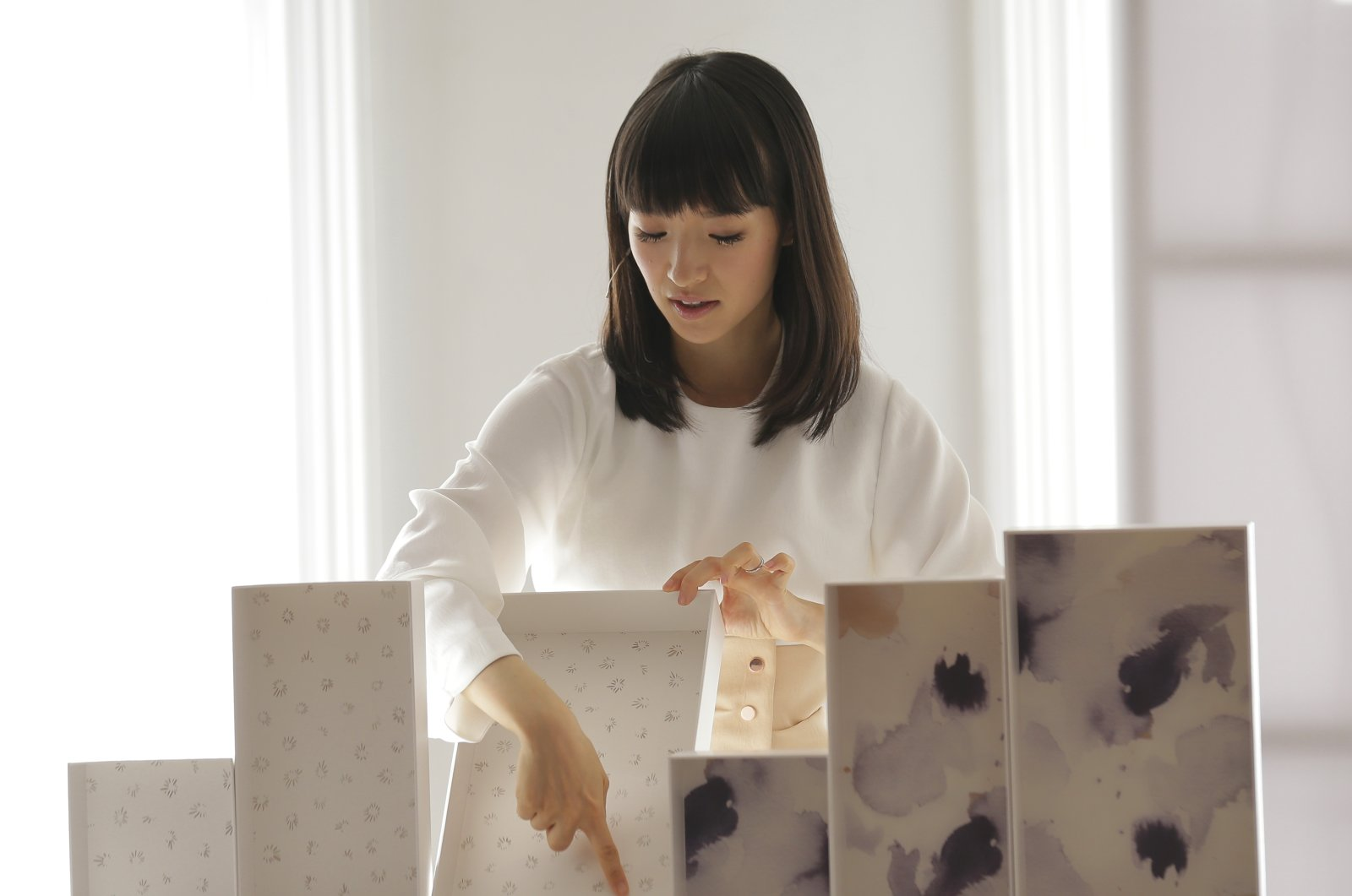 In this July 11, 2018 photo, Japanese organizational expert Marie Kondo displays her line of storage boxes during a media event in New York. (AP Photo)
