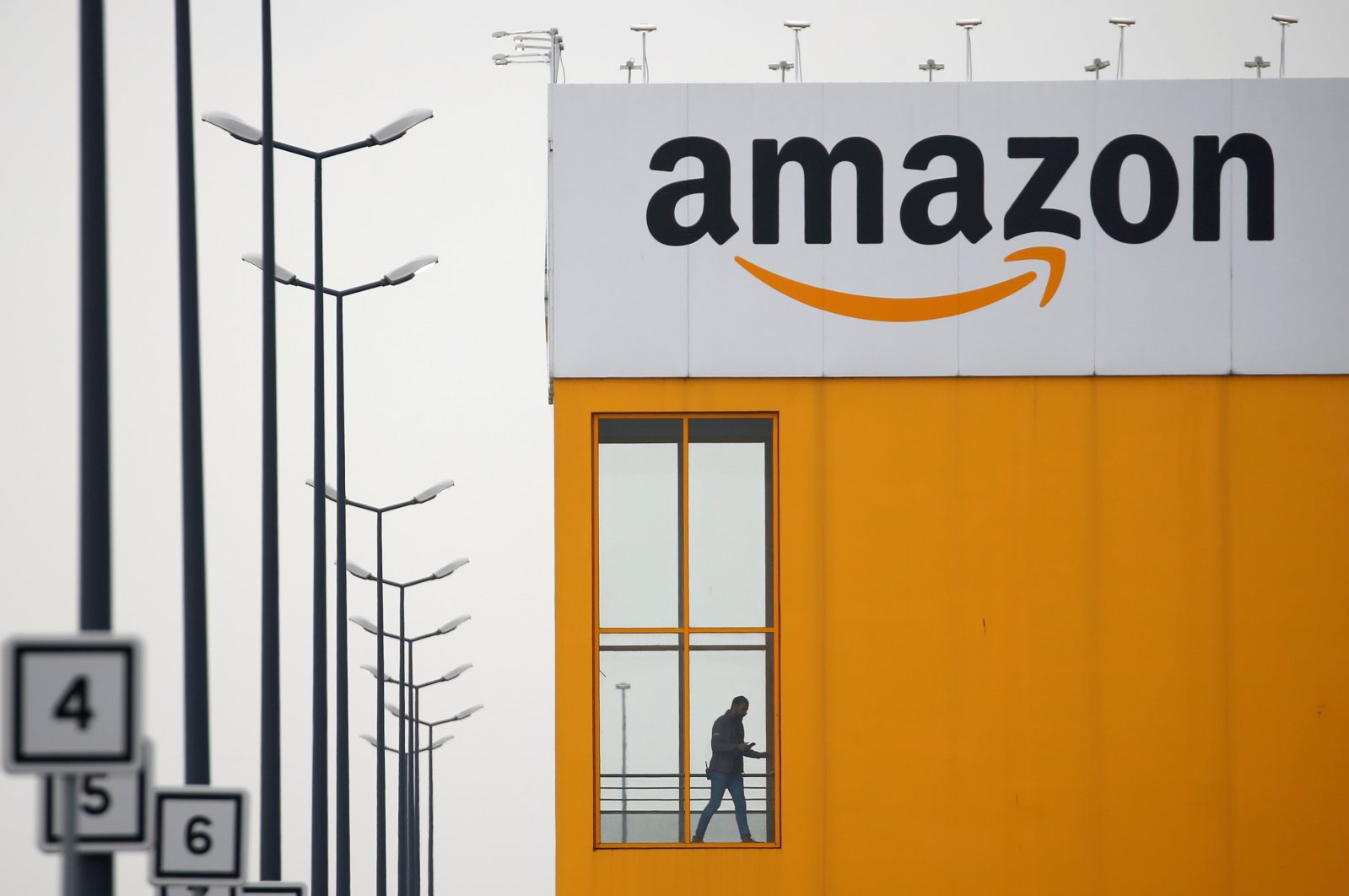 The Amazon logo is seen at the company logistics center in Lauwin-Planque, northern France, March 19, 2020. (Reuters Photo)