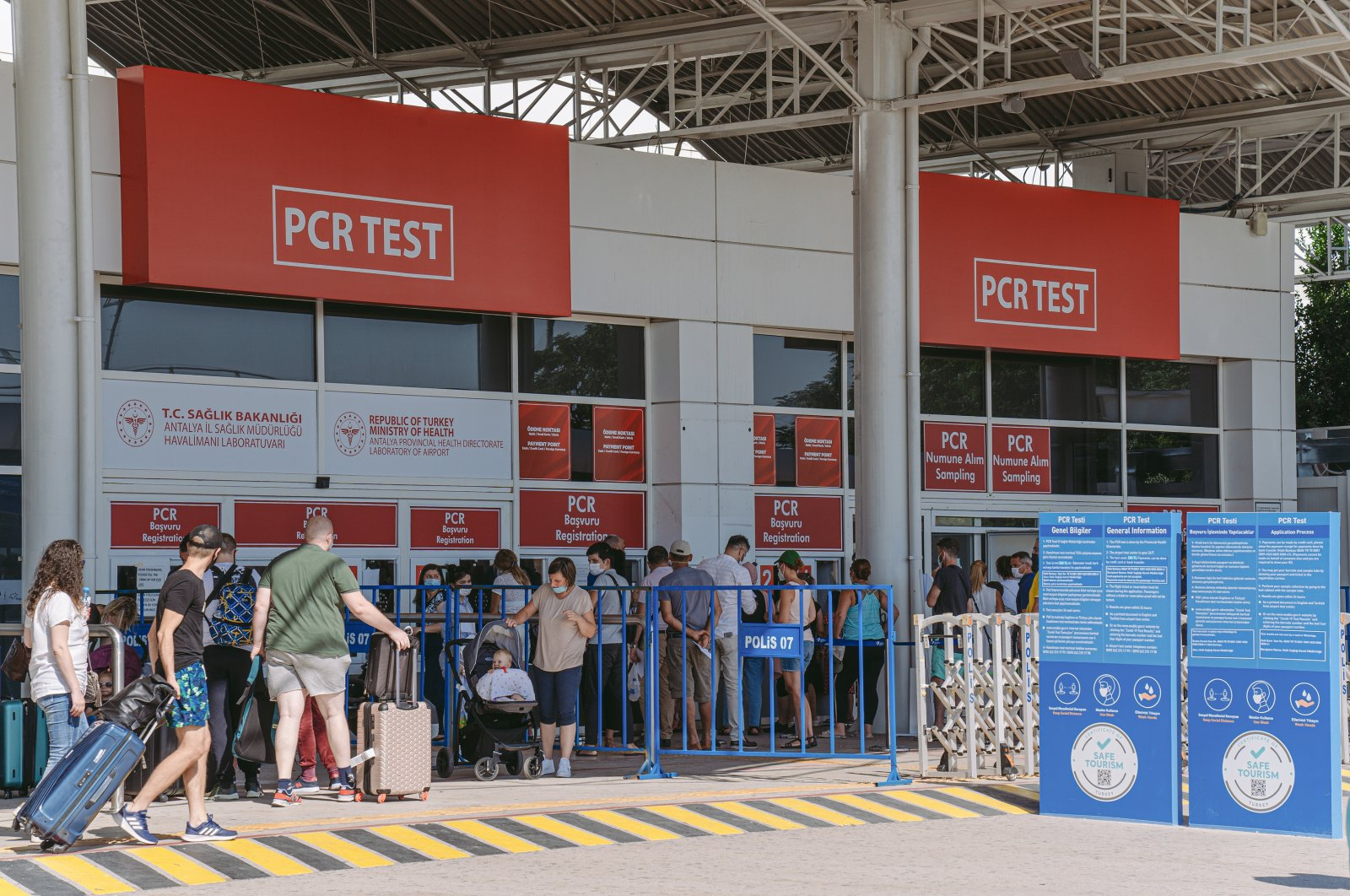 Tourists queue at the PCR test laboratory after arrival at the airport, Antalya, southern Turkey, Sept. 4, 2020. (Shutterstock Photo by Andrii Oleksiienko)