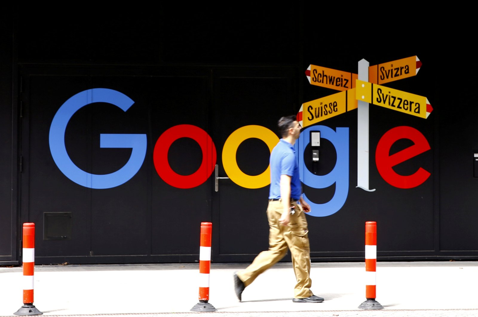 A man walks past a logo of Google in front of at an office building in Zurich, Switzerland, July 1, 2020. (Reuters Photo)
