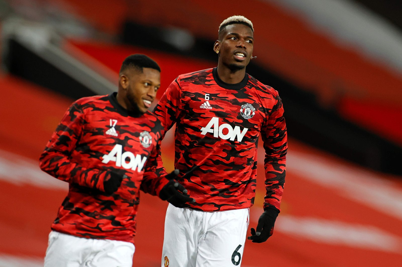 Manchester United's Fred (L) and Paul Pogba warm up ahead of a Premier League match against Manchester City at the Old Trafford stadium in Manchester, England, Dec. 12, 2020. (AFP Photo)