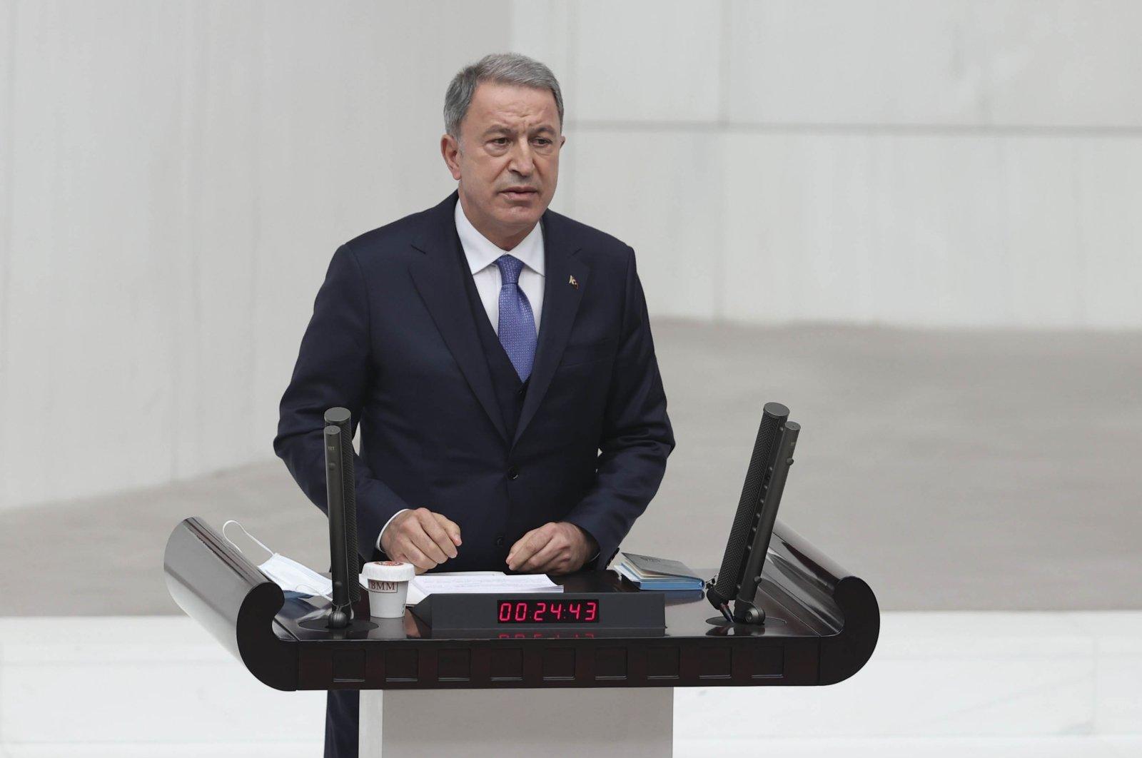 Defense Minister Hulusi Akar gives a speech at the Turkish parliament, Ankara, Dec. 9, 2020. (AA)