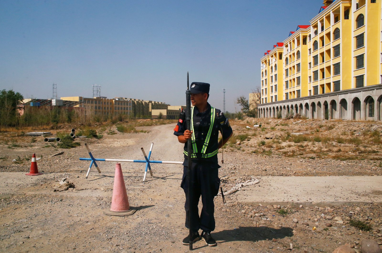 A Chinese police officer takes his position by the road near what is officially called a vocational education center in Yining in the Xinjiang Uighur Autonomous Region, China, Sept. 4, 2018. (Reuters Photo)