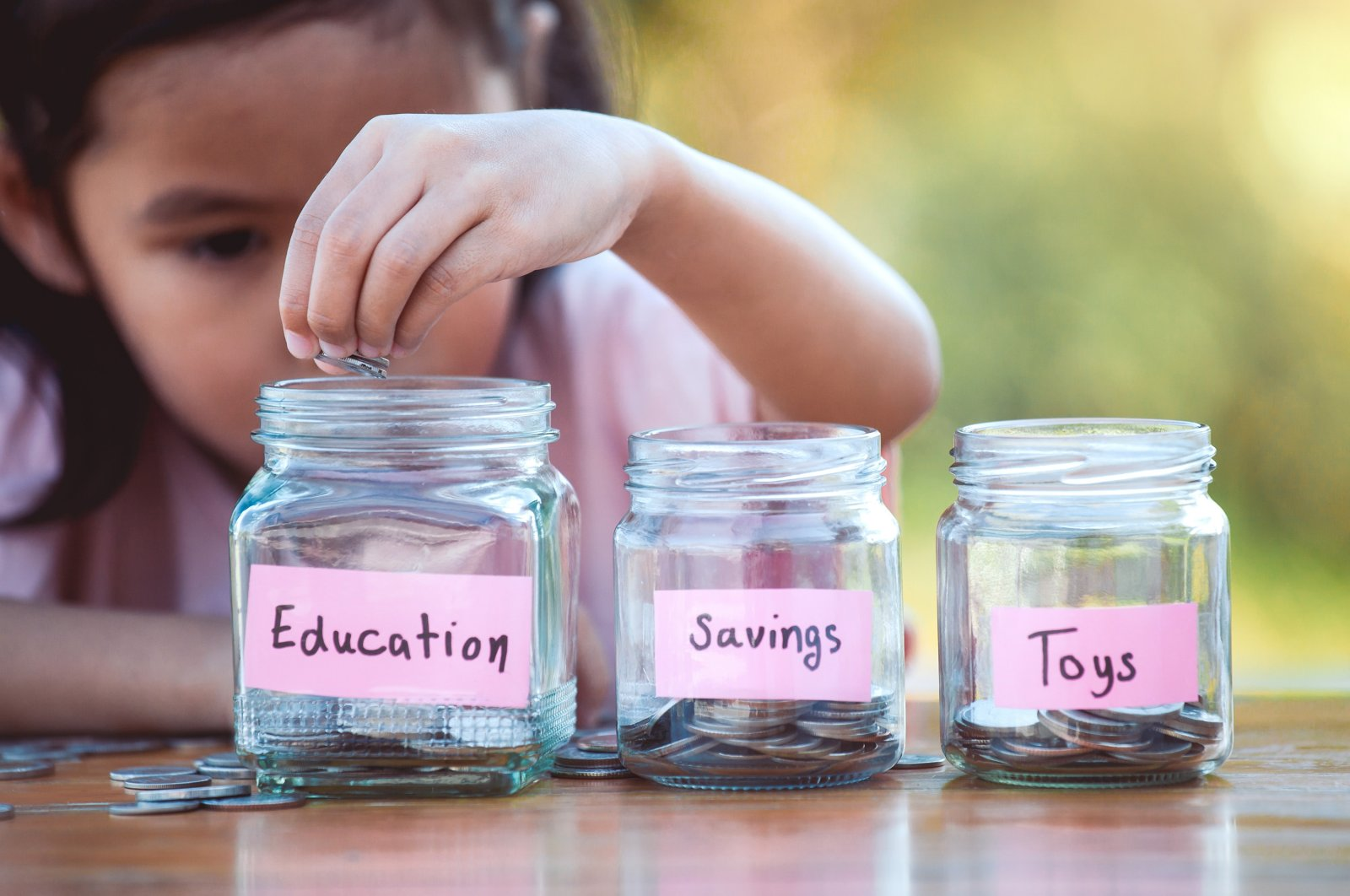 When it comes to money management, experts say the earlier children learn it, the better. (Shutterstock Photo)
