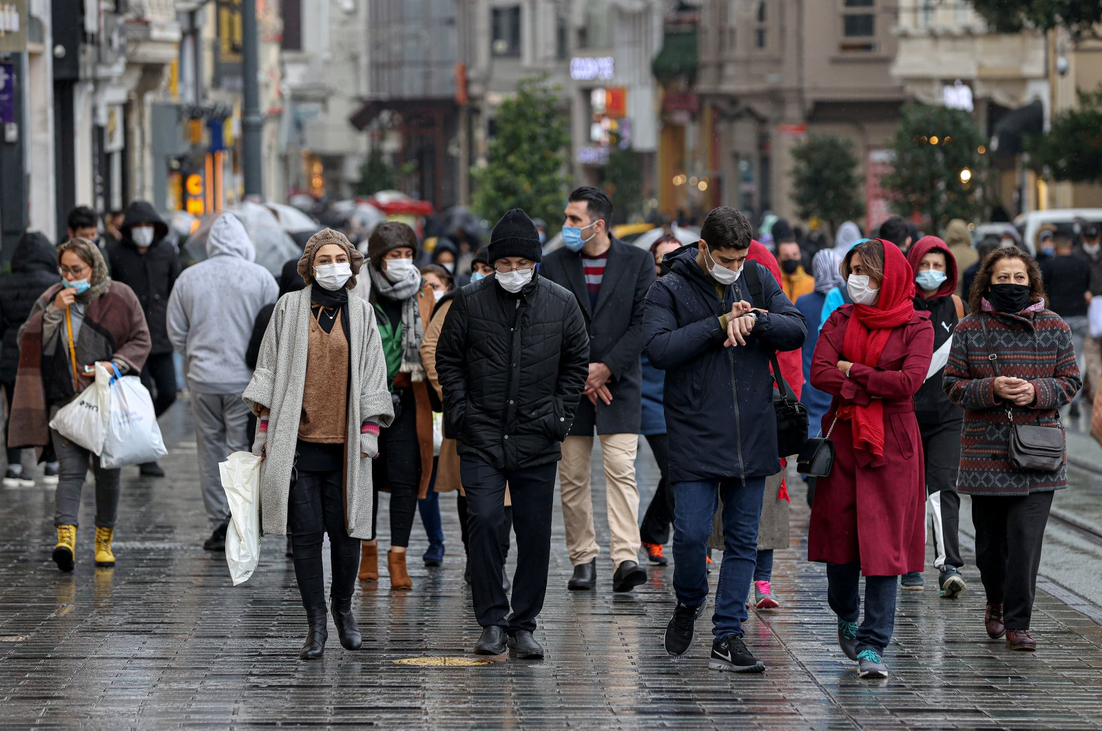 People walk on Istiklal Avenue in Istanbul, Turkey, Dec. 14, 2020. (AA PHOTO)