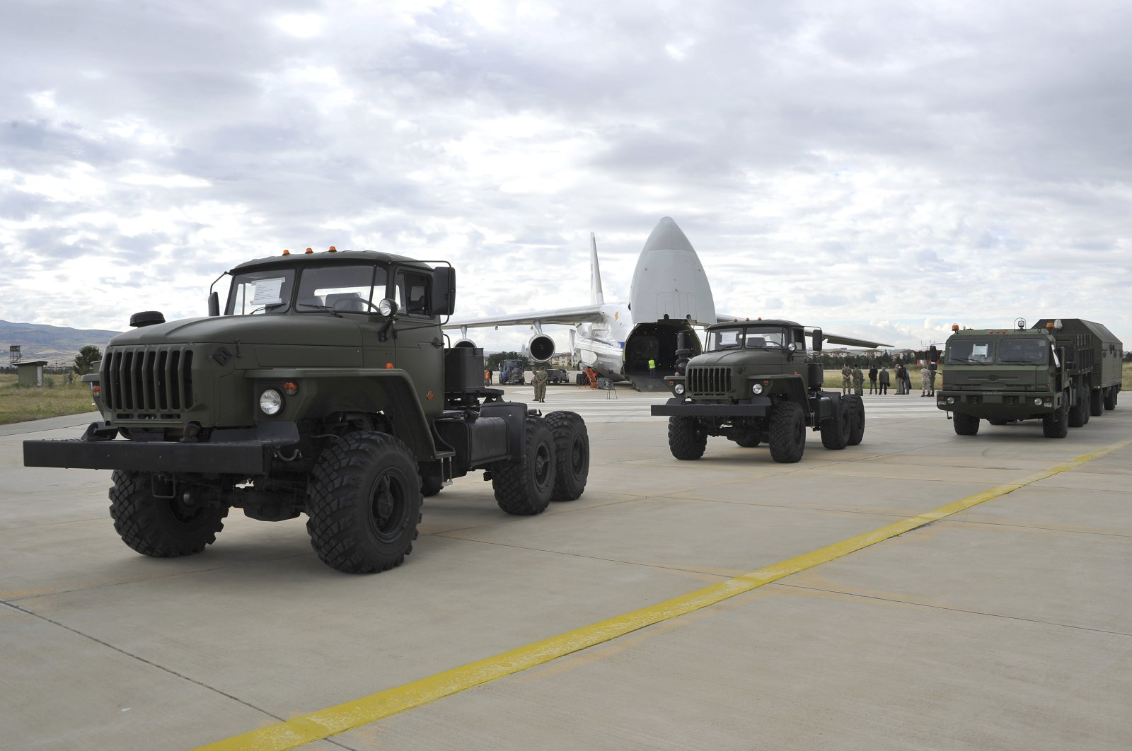 Military vehicles and equipment, parts of the S-400 air defense systems, are seen on the tarmac, after they were unloaded from a Russian transport aircraft, at Murted military airport in Ankara, Turkey, Friday, July 12, 2019. (Turkish Defense Ministry via AP, Pool)
