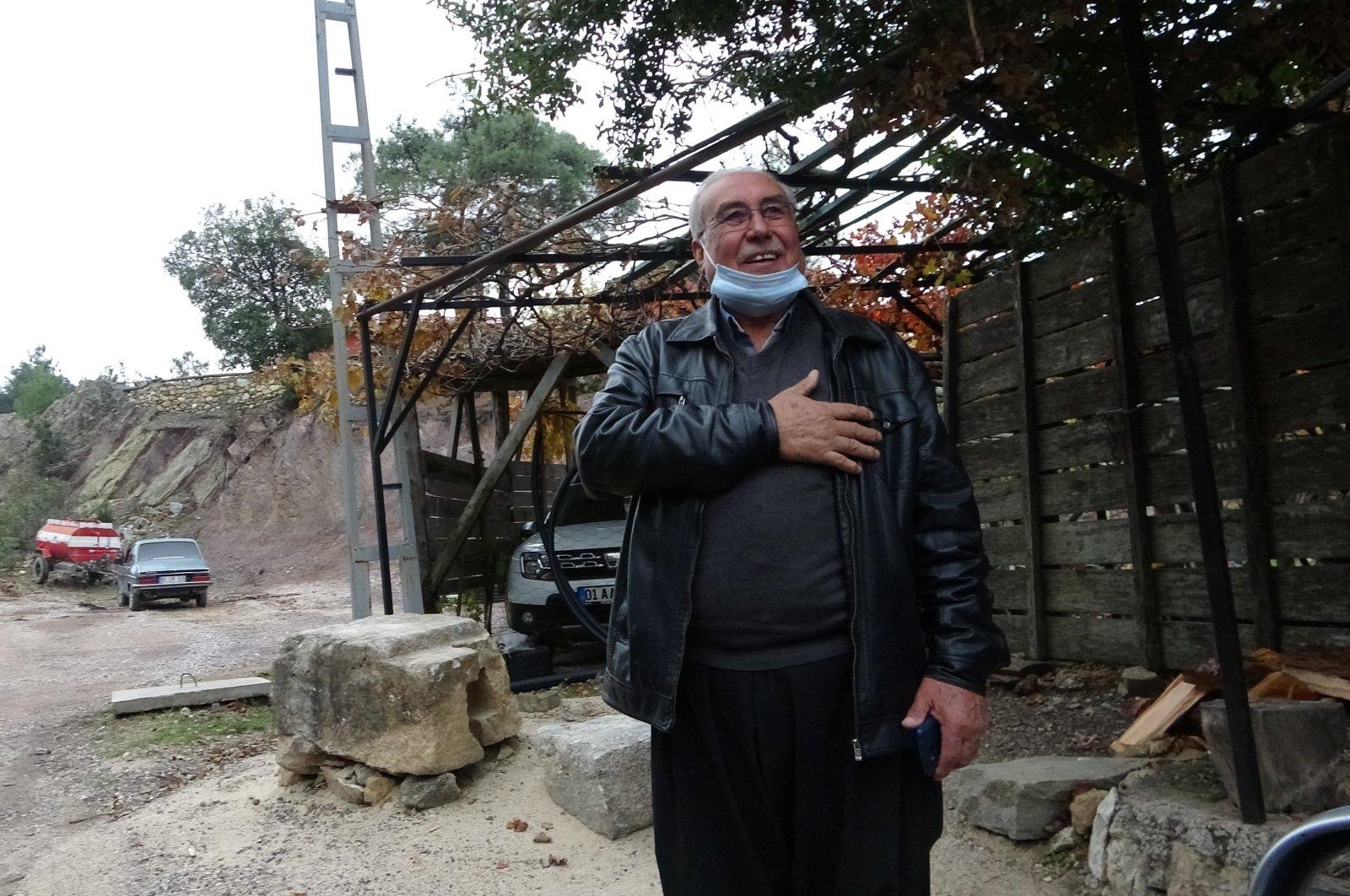 Mehmet Avcı, 70, who has been mukhtar of Kozan's Özbaşı neighborhood for 43 years in Adana, Turkey, Dec. 15, 2020. (IHA)
