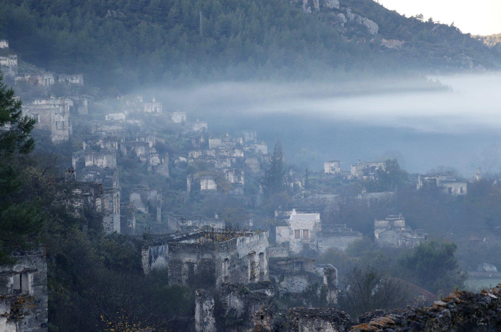 Abandoned buildings seen through fog in Kayaköy, Muğla province, Dec. 11, 2020. (AA Photo)