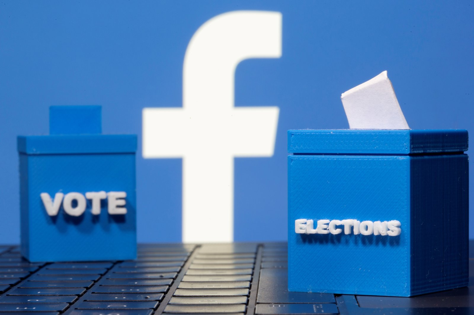 3D printed ballot boxes are seen in front of a displayed Facebook logo in this illustration taken Nov. 4, 2020. (Reuters Photo)
