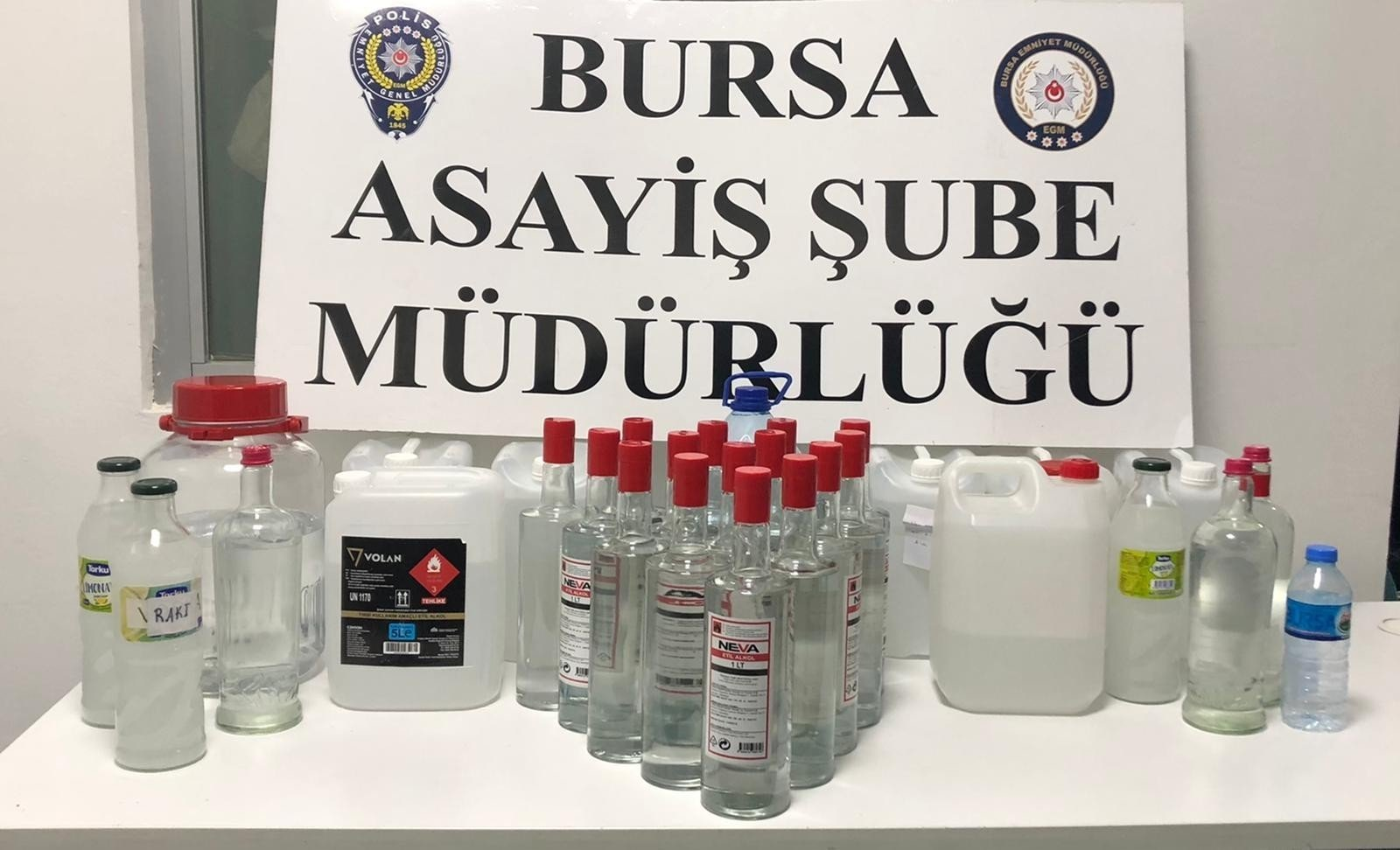 Police exhibit bootleg alcohol seized in operations in Bursa, northwestern Turkey, Dec. 16, 2020. (IHA PHOTO)