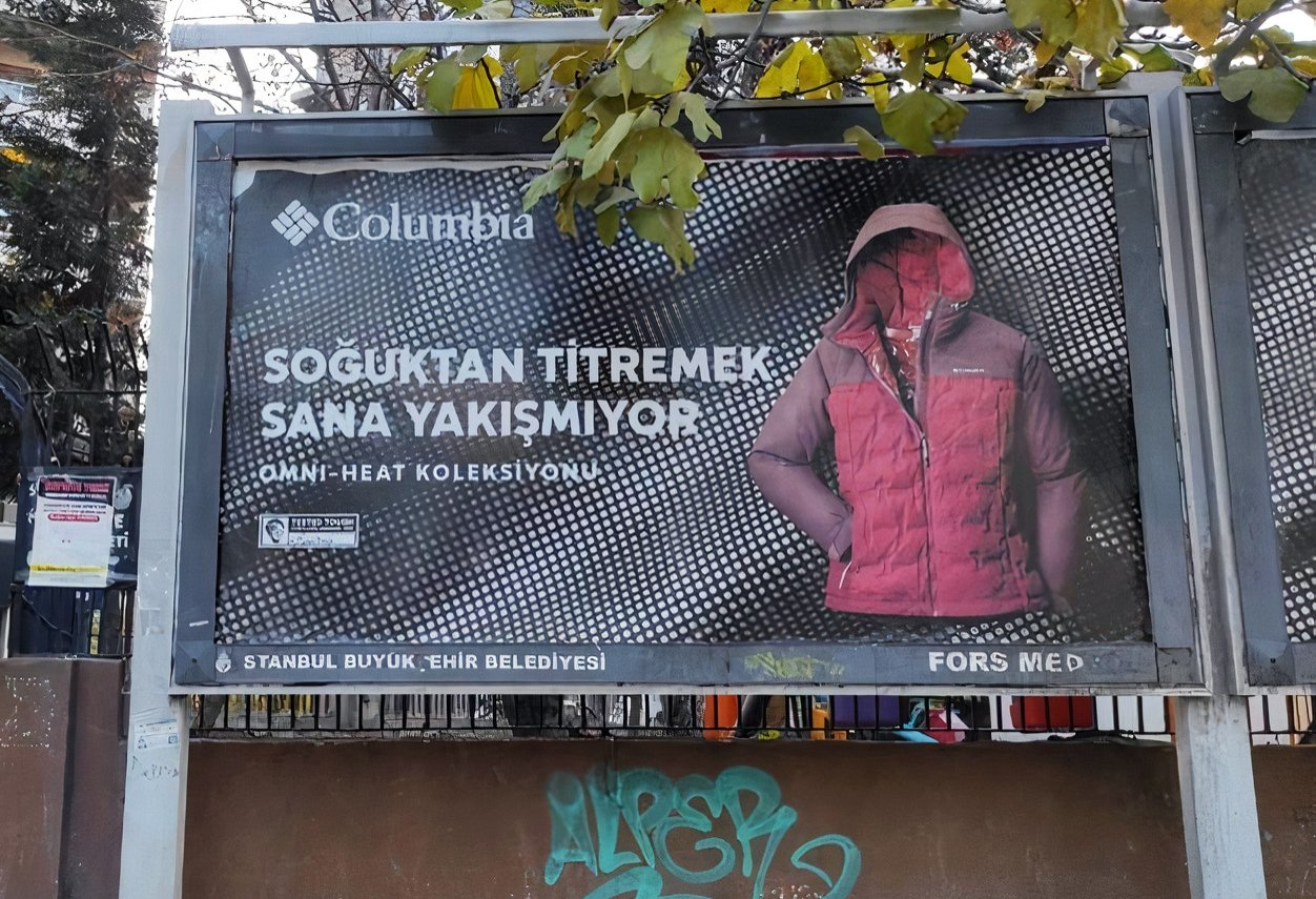 "Columbia Turkey's advertisement is seen on a billboard, reading ""shivering with cold does not suit you,"" in this photo that went viral on social media."