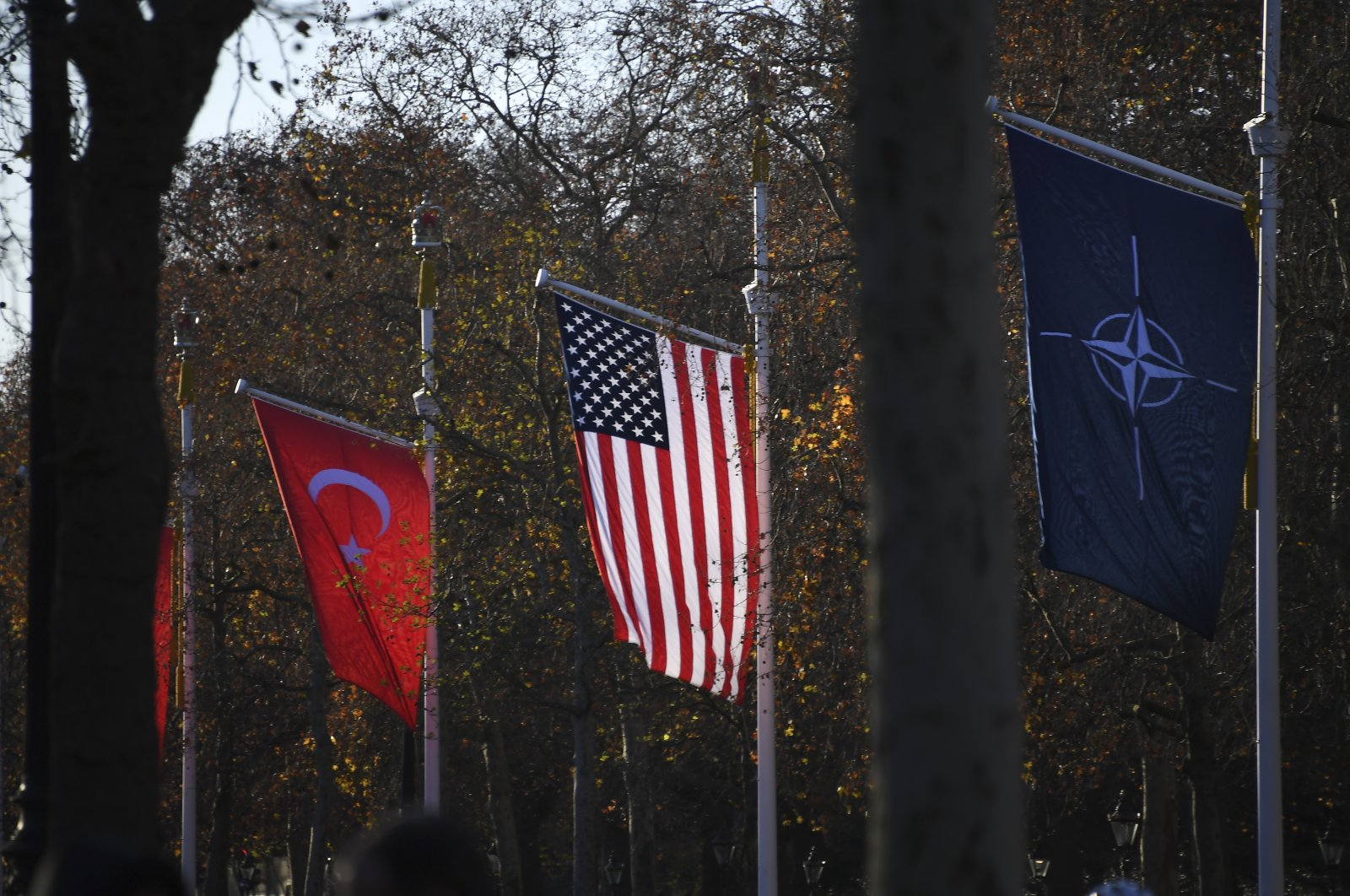 The flags of Turkey, the U.S. and NATO line The Mall at Buckingham Palace, London, the U.K., Dec. 3, 2019. (AP Photo)