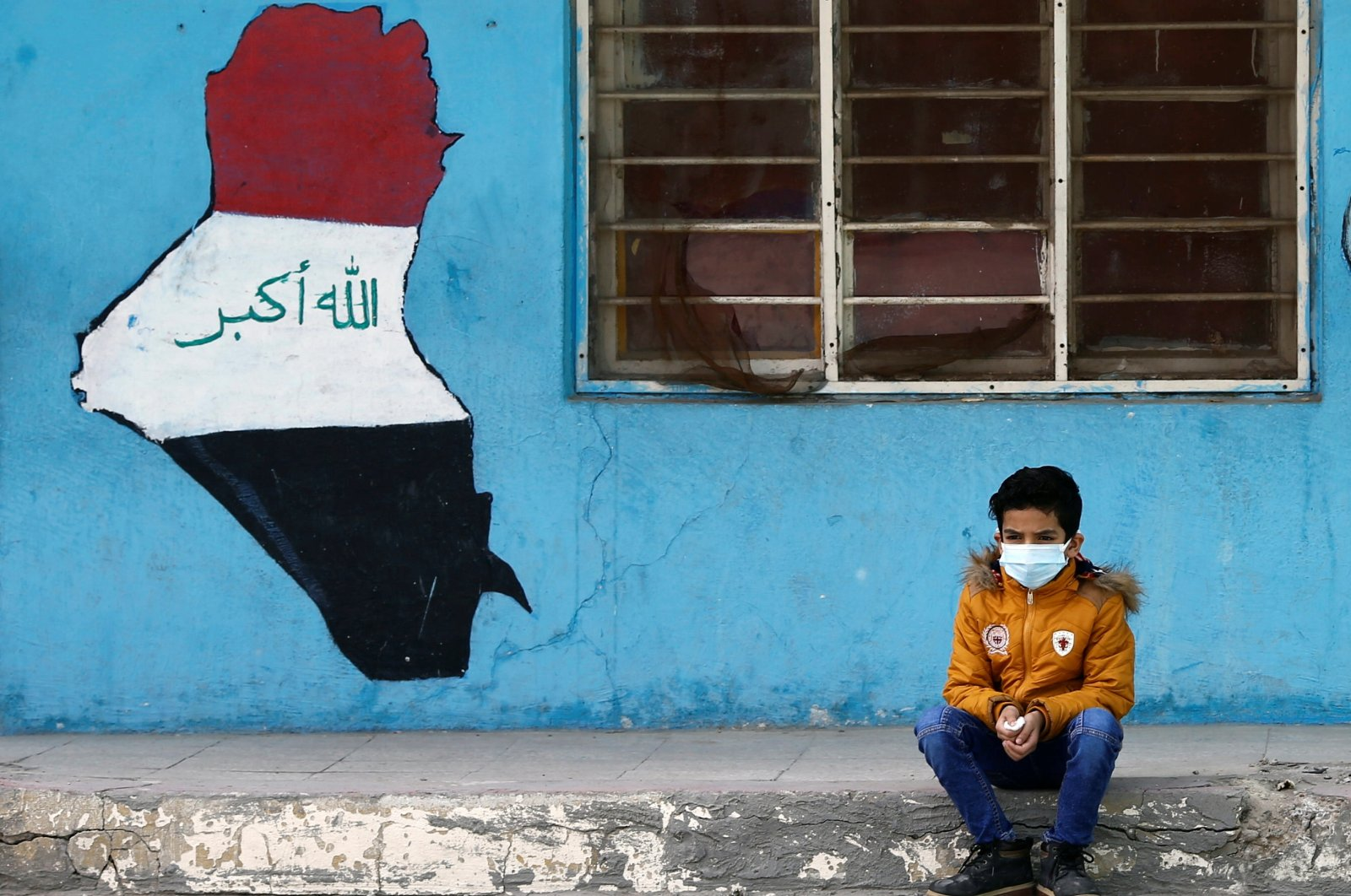 A student wearing a protective mask, amid the outbreak of COVID-19, sits at a school in Baghdad, Iraq, Dec. 14, 2020. (Reuters Photo)