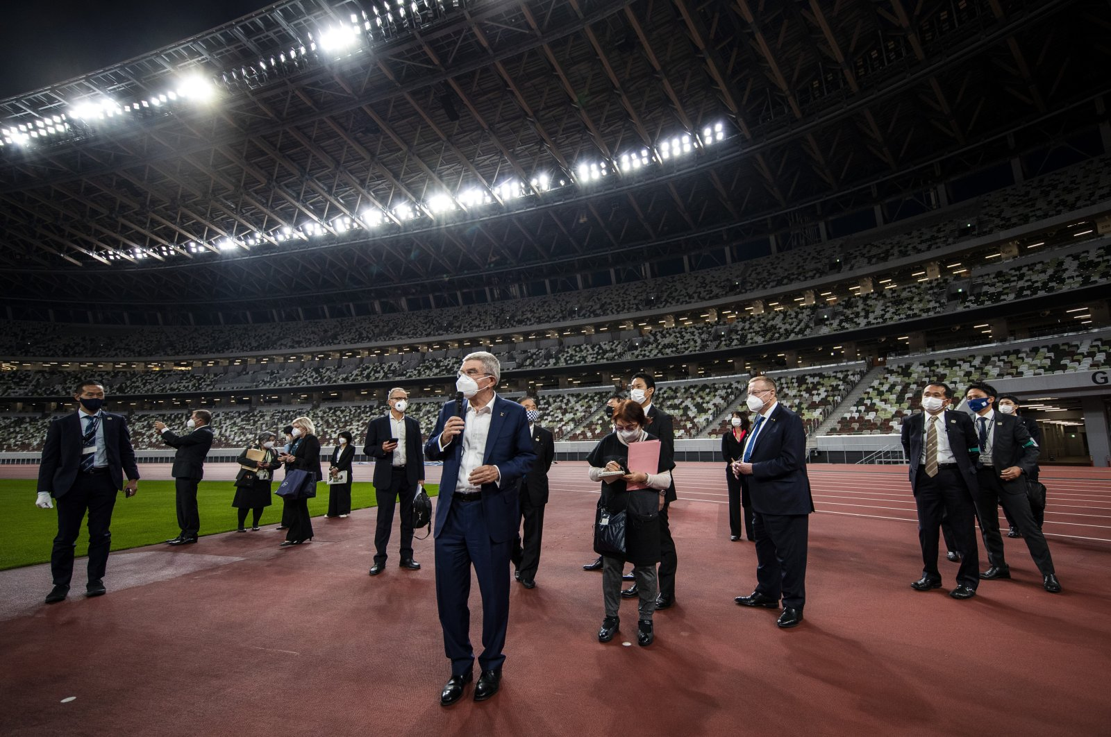 International Olympic Committee (IOC) President Thomas Bach (C) visits the National Stadium, the main venue for the 2020 Olympics, in Tokyo, Japan, Nov. 17, 2020. (AP Photo)