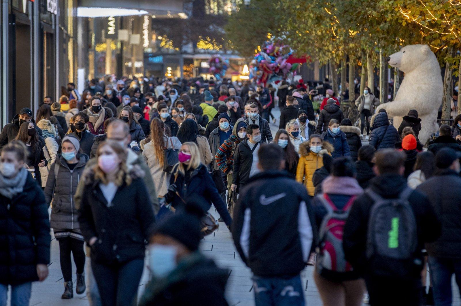 People walk in the main pedestrian zone in Frankfurt, Germany, Dec. 14, 2020. (AP Photo)