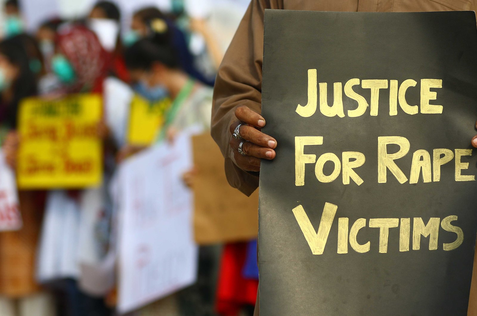 Activists of V-care welfare trust hold placards during a protest against the alleged gang rape of a woman, Karachi, Pakistan, Sept. 13, 2020. (EPA Photo)