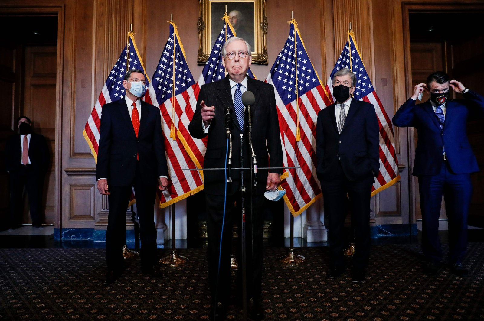 U.S. Senate Majority Leader Mitch McConnell is flanked by Senators John Barrasso and John Thune as he speaks during a news conference with other Senate Republicans at the U.S. Capitol in Washington, DC, on Dec. 15, 2020. (AFP Photo)