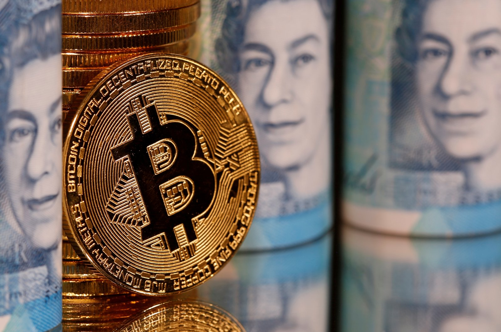 Representations of Bitcoin and pound banknotes are seen in this illustration taken Jan. 6, 2020. (Reuters Photo)