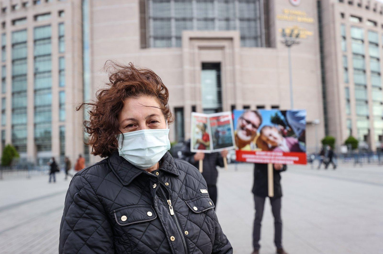 Emine Öztürk protests the imprisonment of his husband Mehmet Ali Öztürk in the UAE in front of a courthouse in Istanbul, Turkey, Dec. 11, 2020. (AA Photo)
