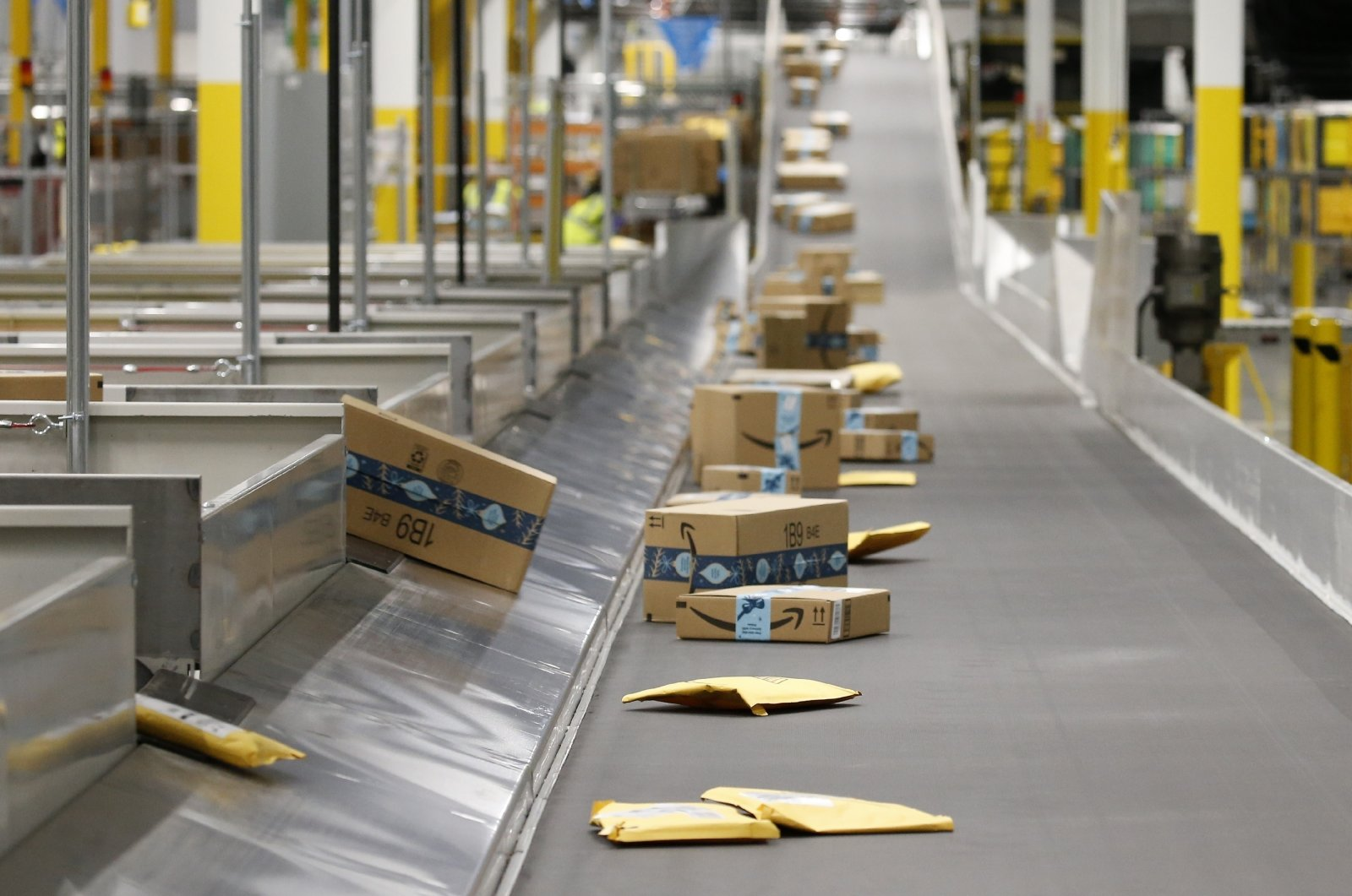 Amazon packages move along a conveyor at an Amazon warehouse facility in Goodyear, Arizona on Dec. 17, 2019. (AP Photo)