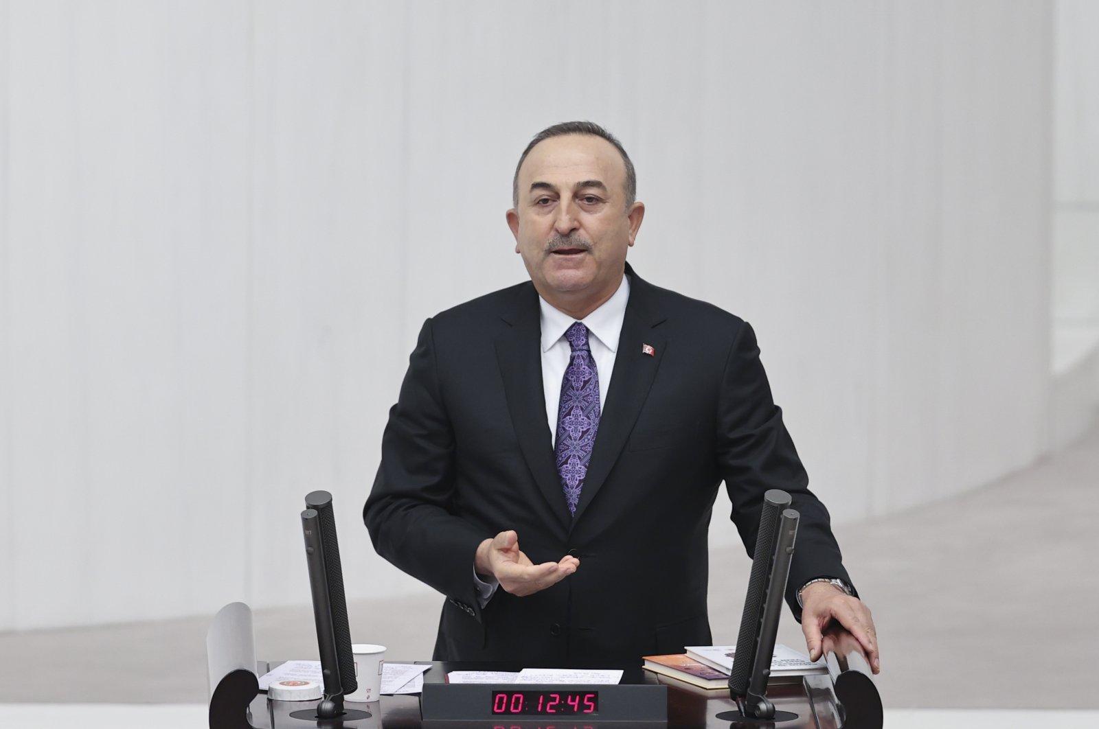 Foreign Minister Mevlüt Çavuşoğlu speaks at the Turkish Parliament in Ankara, Turkey, Dec. 14, 2020. (AA Photo)