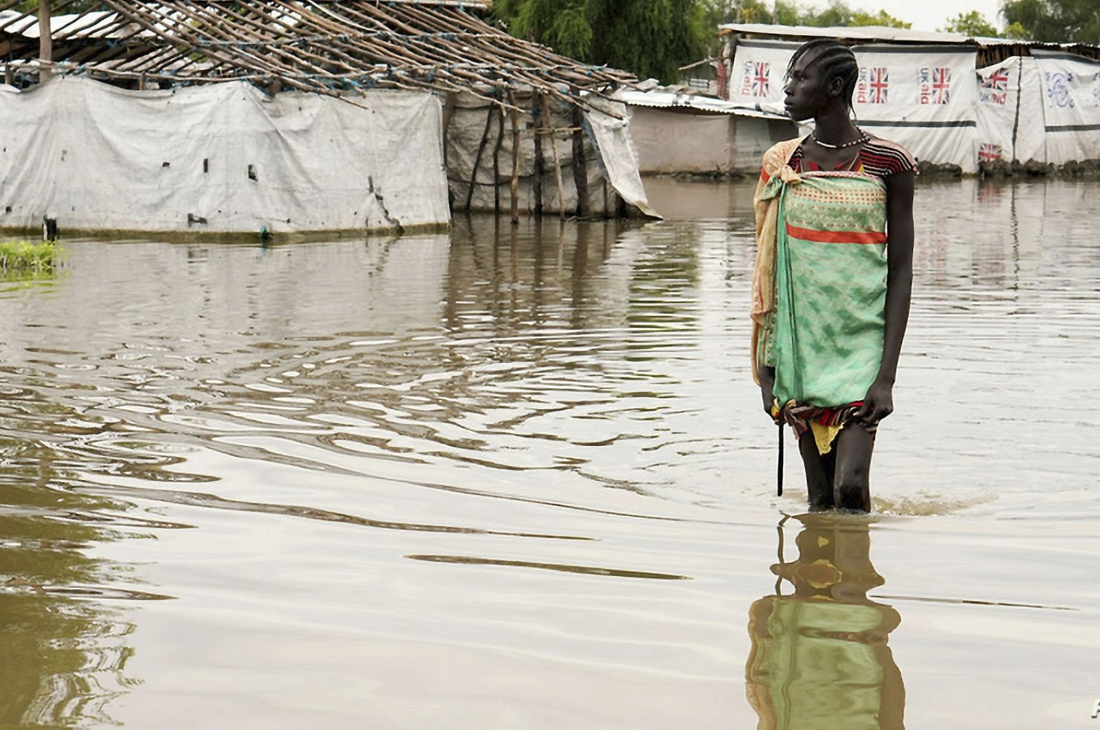 A girl walks in water after heavy rains and floods forced hundreds of thousands of people to leave their homes, in the town of Pibor, Boma state, South Sudan, Nov. 6, 2019. (Reuters Photo)