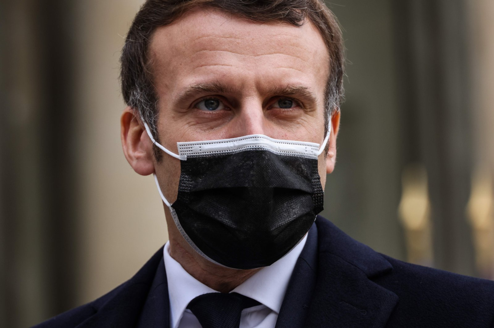 French President Emmanuel Macron addresses reporters upon the arrival of the Portuguese prime minister for a working lunch at the Elysee Palace in Paris, France, Dec. 16, 2020. (AFP Photo)