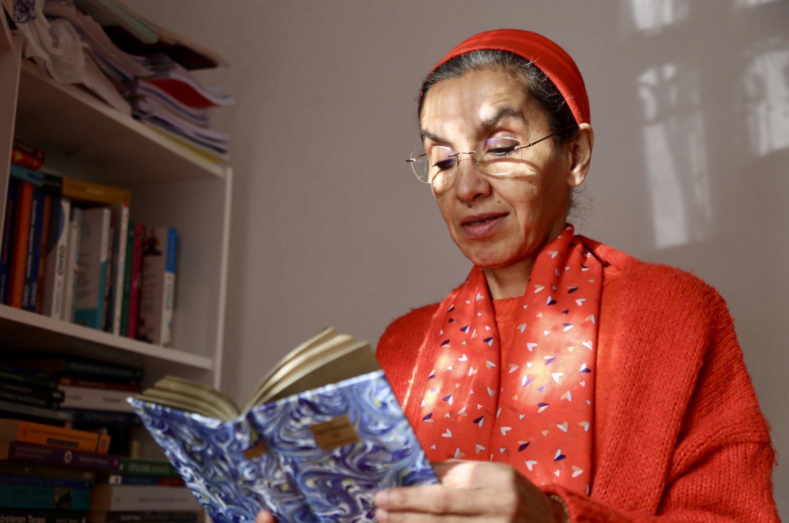 Swamini Samvidananda Saraswati reads a book by Rumi in her home, in Konya, Turkey, Dec. 17, 2020. (AA Photo)
