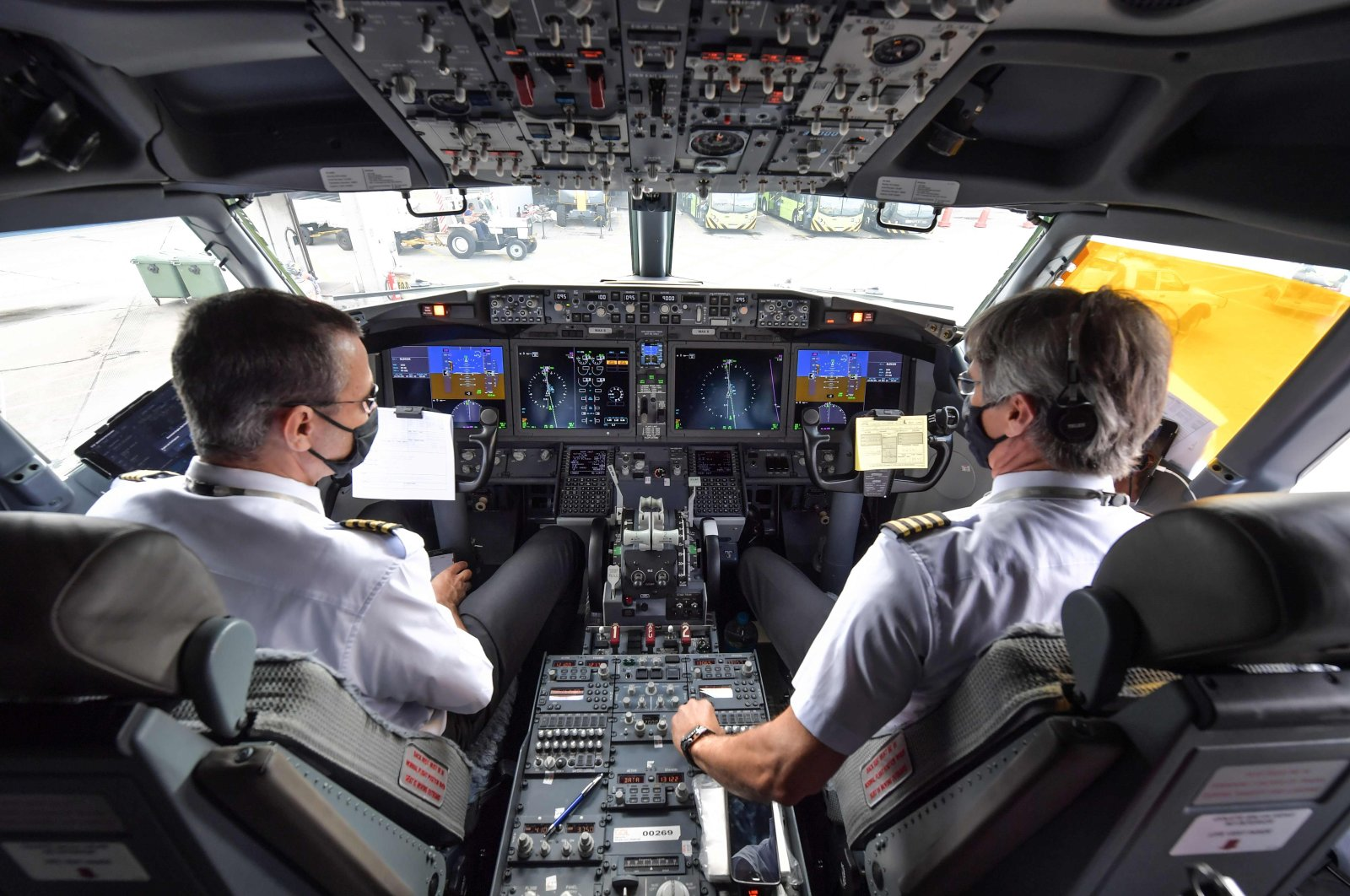 Pilots are pictured in the cockpit of a Boeing 737 Max aircraft operated by low-cost airline Gol as it sits on the tarmac before takeoff at Guarulhos International Airport, near Sao Paulo, Brazil, Dec. 9, 2020. (AFP Photo)