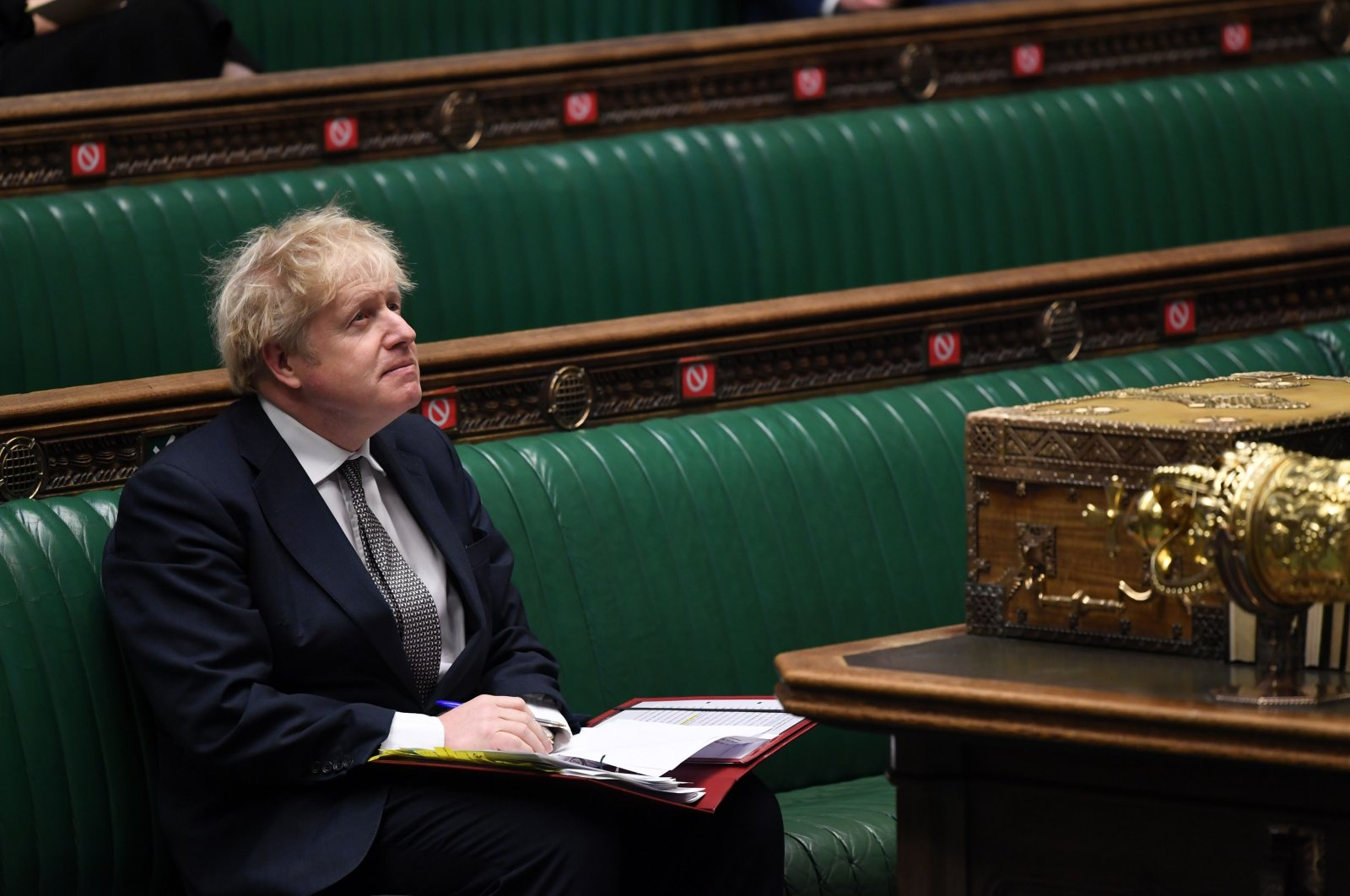 A handout photograph released by the U.K. Parliament shows Britain's Prime Minister Boris Johnson attending Prime Minister's Questions (PMQs), in a socially distanced and hybrid session of the House of Commons, in central London, Britain, Dec. 16, 2020. (AFP Photo)
