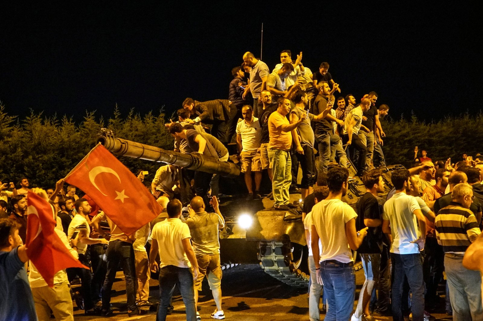 People gather on top of a tank, standing against the Gülenist coup attempt, at Atatürk Airport, Istanbul, Turkey, July 16, 2016. (Photo by Getty Images)