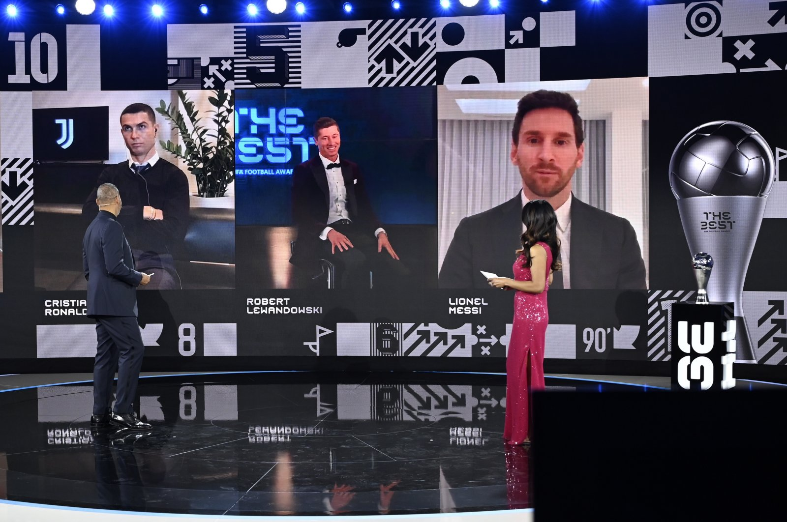 Bayern Munich striker Robert Lewandowski (C on screen) appears on screen with fellow finalists Cristiano Ronaldo (L) and Lionel Messi after receiving the Best FIFA Men's Player Award during the Best FIFA Football Awards virtual TV show broadcast from the FIFA headquarters in Zurich, Switzerland, Dec. 17, 2020.  (EPA Photo)