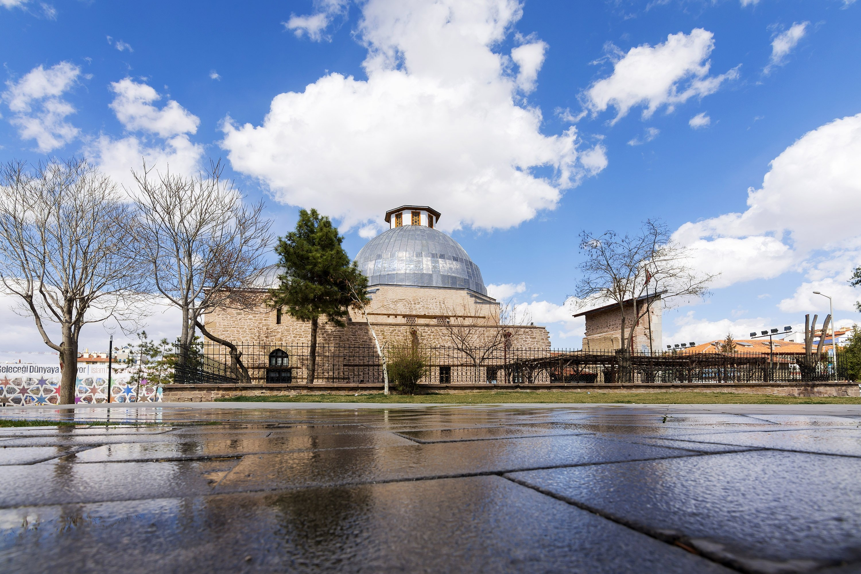 The Karatay Madrassa and its reflection are seen on a road in Konya, central Turkey, March 10, 2016. (Shutterstock Photo)