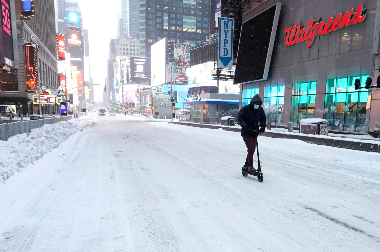 A man travels on a scooter in Times Square in the morning after a powerful winter storm hit America's northeastern states, New York City, U.S., Dec. 17, 2020. (AFP Photo)