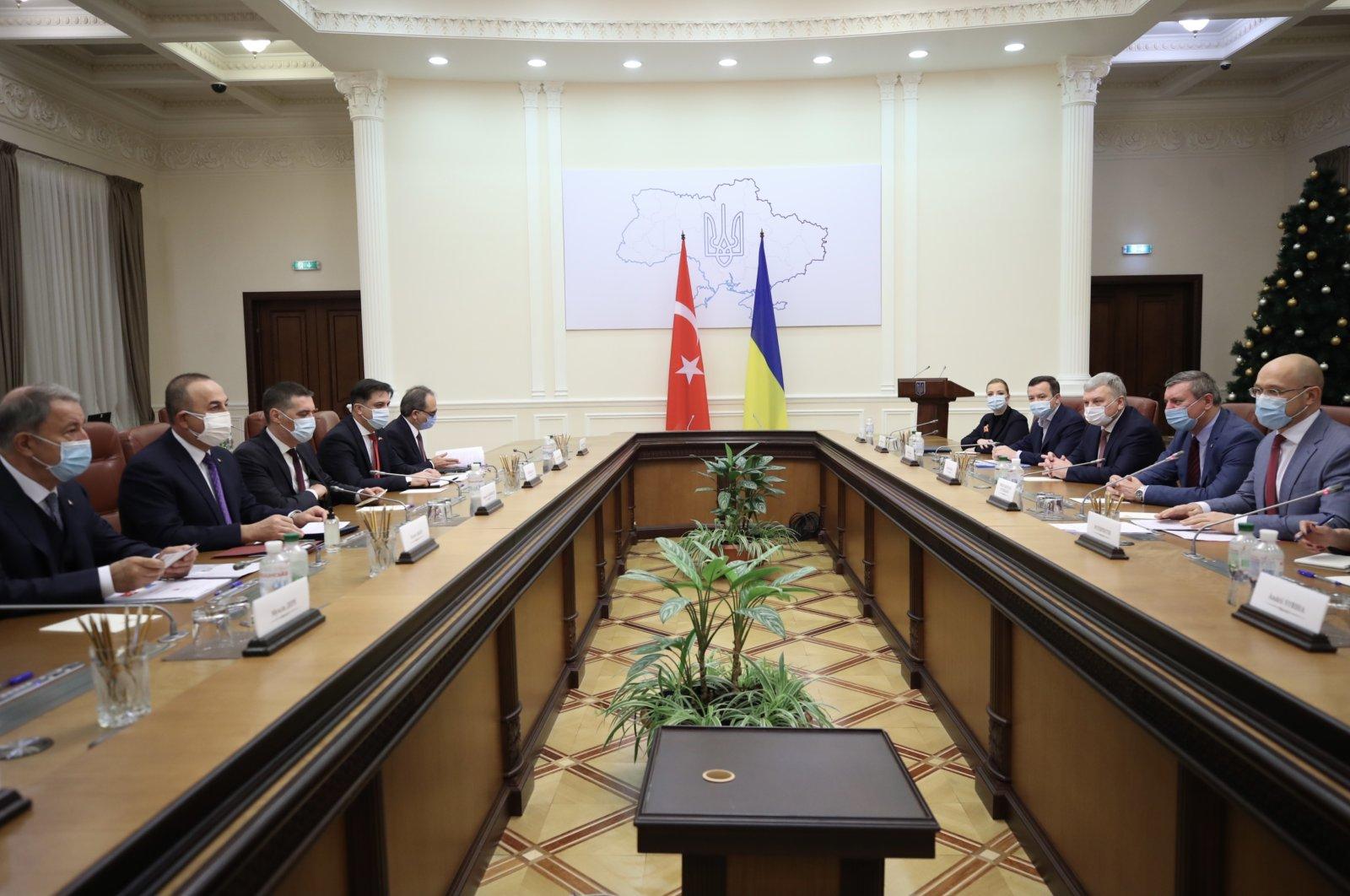 Defense Minister Hulusi Akar (1st L) and Foreign Minister Mevlüt Çavuşoğlu (2nd L) meet with Ukrainian Prime Minister Denys Shmyhal (2nd R) in Kyiv, Ukraine, Dec. 18, 2020. (AA Photo)