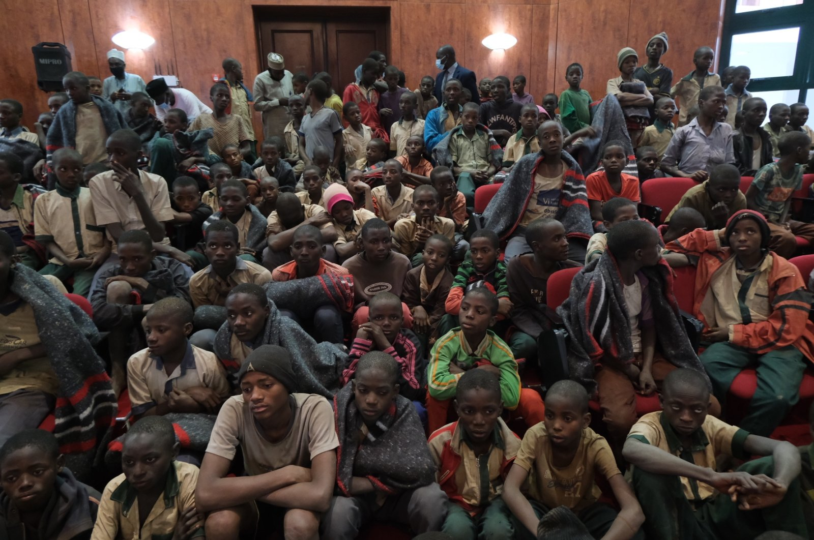 Students gather at the Government House with other students from the Government Science Secondary school, in Kankara, in northwestern Katsina State, Nigeria following their release on Dec. 18, 2020. (AFP Photo)