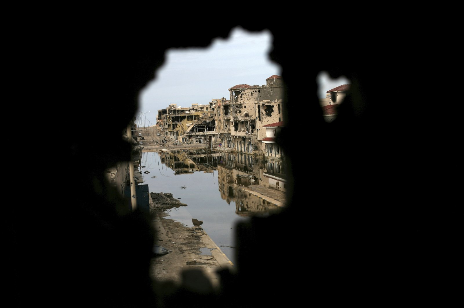 Buildings ravaged by fighting are seen through another damaged building in Sirte, Libya, Oct. 22, 2011. (AP Photo)