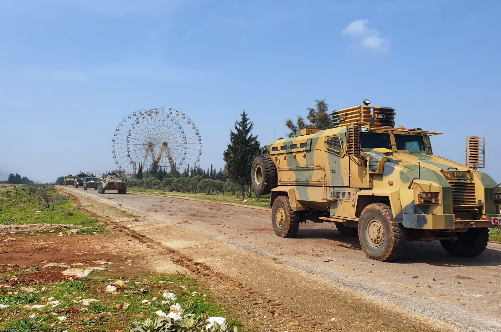 Turkish and Russian troops patrol on the M4 highway, which runs east-west through Idlib province, Syria, March 15, 2020. (AP Photo)