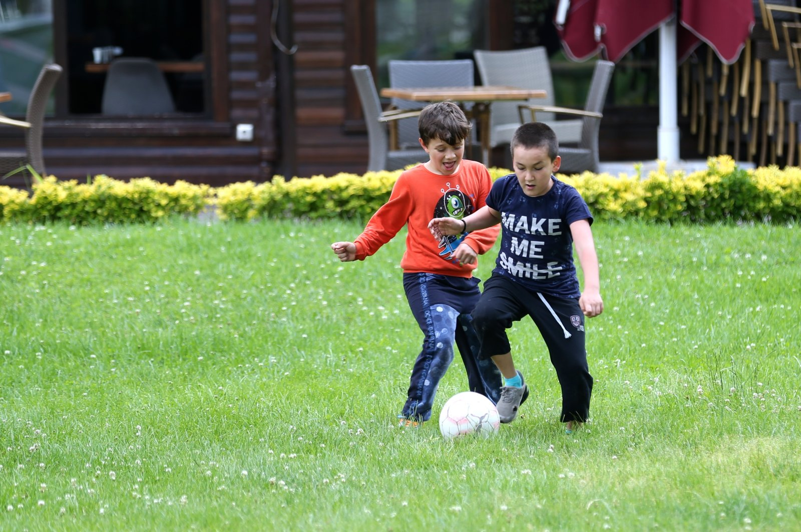 Two boys play football in a yard in Sakarya, northwestern Turkey, June 3, 2020. (AA Photo)
