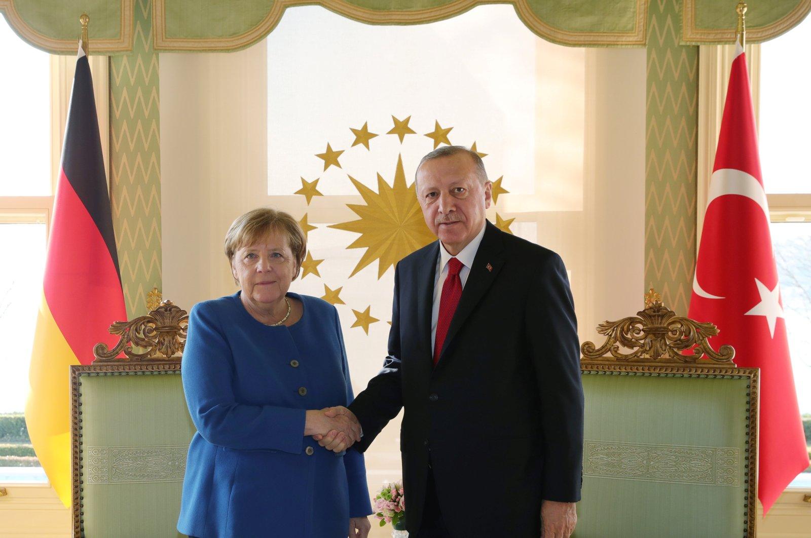 President Recep Tayyip Erdoğan shakes hands with German Chancellor Angela Merkel in Istanbul, Jan. 24, 2020. (Reuters Photo)