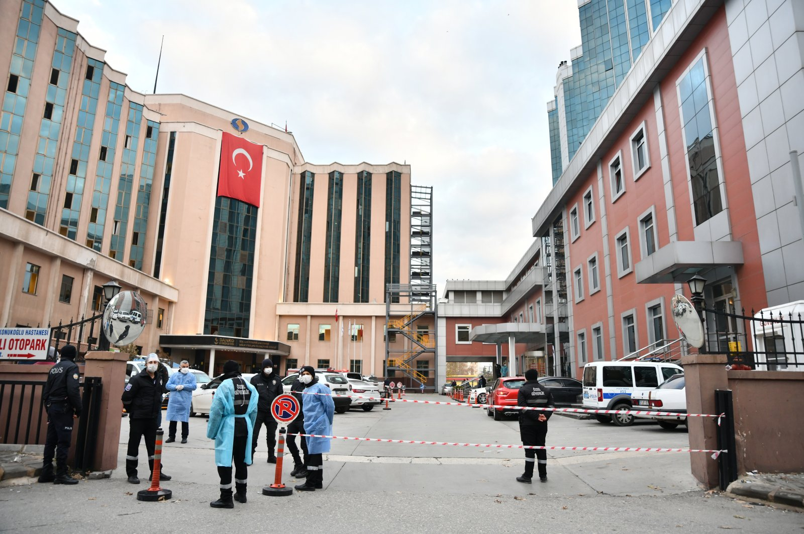 Security personnel stand in front of the SANKO University Hospital following a fire in Gaziantep, Turkey, Dec. 19, 2020. (AA Photo)