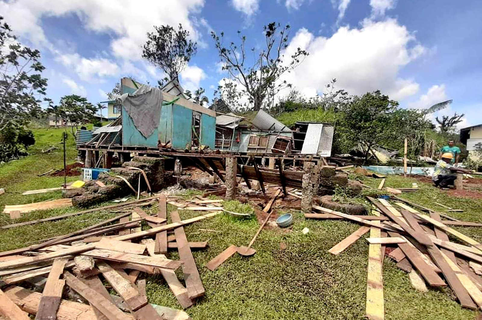 Debris from houses destroyed by Cyclone Yasa lay on the ground, on Vanua Levu Island, Fiji, Dec. 19, 2020. (Fiji Red Cross via AFP)