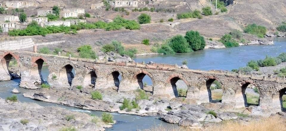The historical Hudaferin Bridge on the Aras River near the Iranian border in Jabrayil in the recently liberated Nagorno-Karabakh region, Azerbaijan.