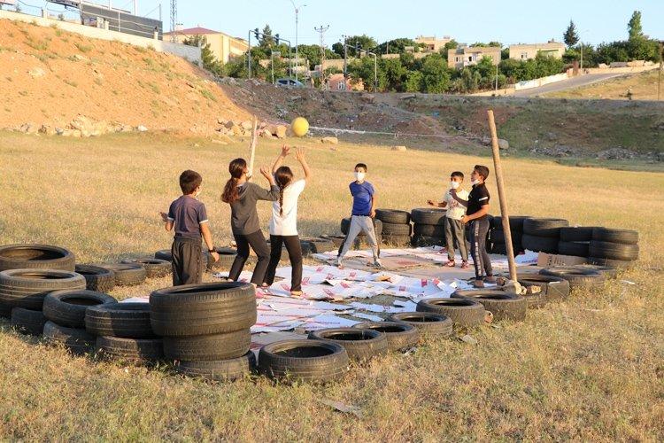 Children play on their makeshift pitch, in Siirt, eastern Turkey, Jun. 11, 2020. (AA PHOTO)