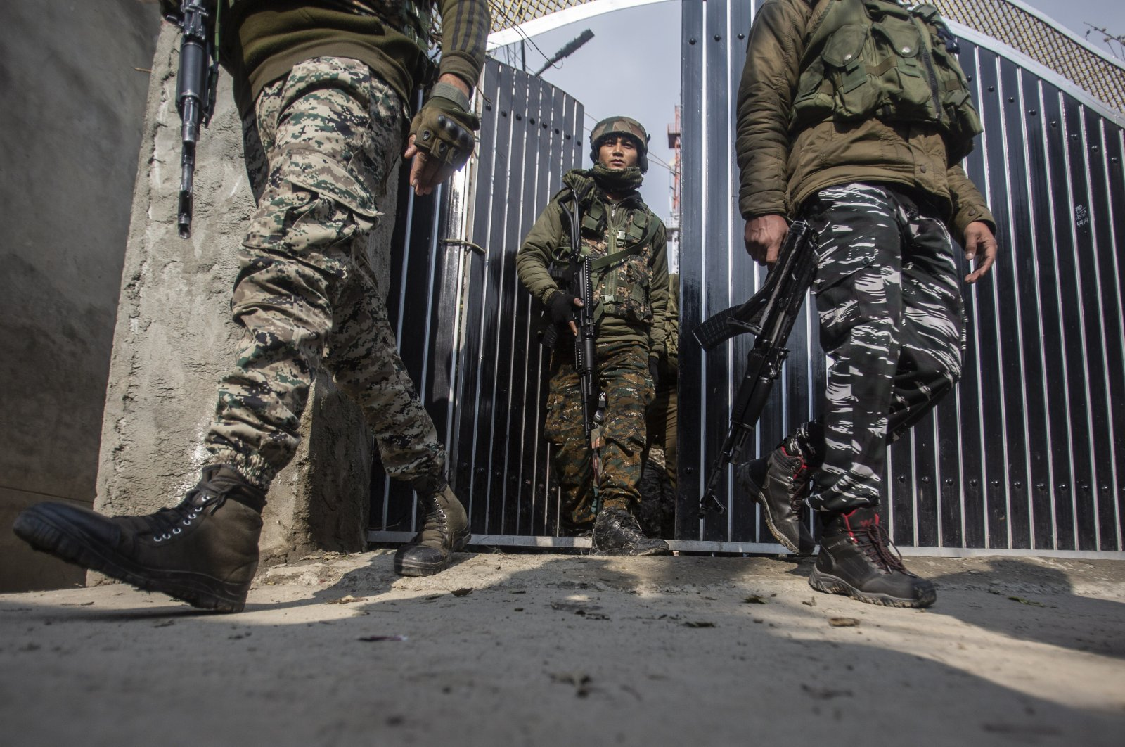 Indian soldiers come out of the house of a leader of the People's Democratic Party where a personal security officer was killed in a rebel attack in Srinagar, Indian controlled Kashmir, Dec. 14, 2020. (AP Photo)