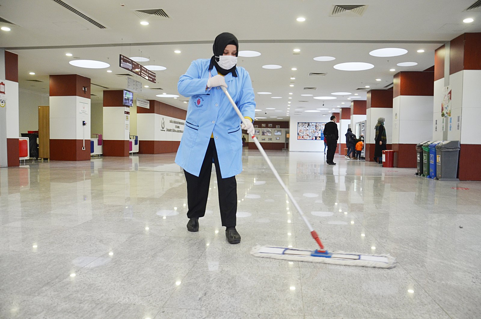 Nurten Gündoğdu cleans the floor at a hospital in Istanbul, Turkey, Dec. 20, 2020. (AA PHOTO)
